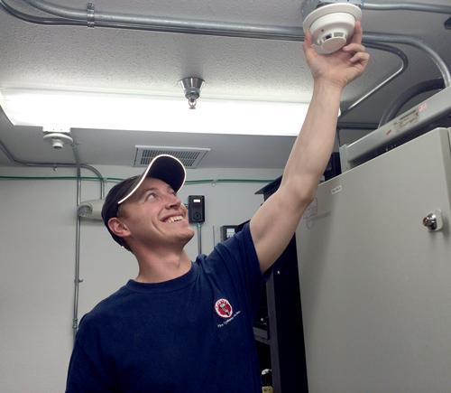 employee-installing-a-smoke-detector